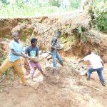 The Water Project: Mukhweso Community, Shemema Spring -  Layering Large Rocks