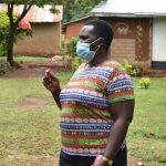 The Water Project: Mukhweso Community, Shemema Spring -  Trainer Emmah Talks Dental Hygiene