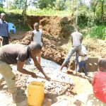 The Water Project: Mukhweso Community, Shemema Spring -  Mixing Concrete
