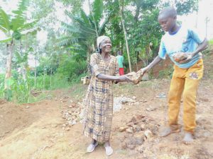 The Water Project:  Passing Smaller Stones For Use