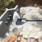 The Water Project: Mukhweso Community, Shemema Spring -  Plastering Rub Wall And Drainage Outlet