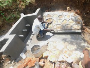 The Water Project:  Plastering Rub Wall And Drainage Outlet
