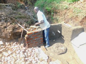 The Water Project:  Plastering The Headwall