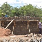 The Water Project: Tyaa Kamuthale Secondary School -  Building Top Of The Tank Wall