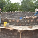 The Water Project: Tyaa Kamuthale Secondary School -  Laying Rocks For Walls