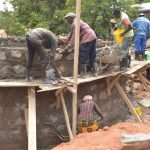 The Water Project: Tyaa Kamuthale Secondary School -  Standing On Scaffolding To Build Tank Walls