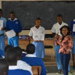 The Water Project: Tyaa Kamuthale Secondary School -  Students Hold Up Training Posters