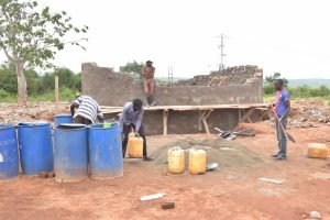 The Water Project:  Mixing Cement For Tank Walls