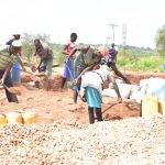 The Water Project: Kamuwongo Primary School -  Parents Working On The Tank