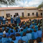 The Water Project: Kamuwongo Primary School -  Students Listen At The Training