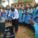 The Water Project: Kamuwongo Primary School -  Teacher Participates In Handwashing Demonstration