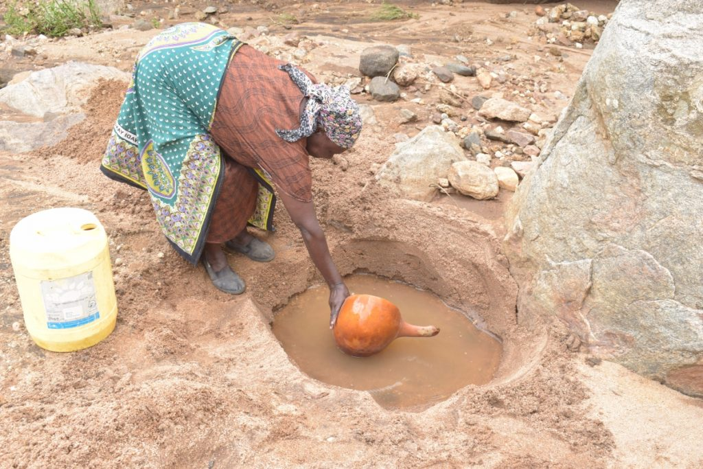 The Water Project : kenya21410-kenya21411-collecting-water-at-the-open-source