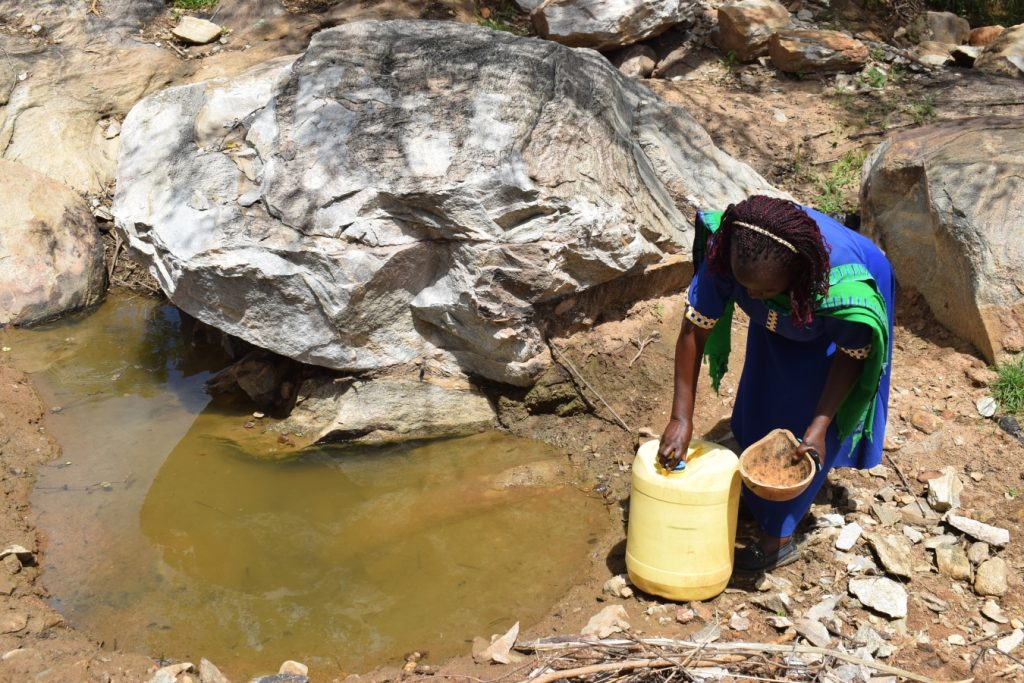 The Water Project : kenya21412-21413-gathering-water-at-the-scoop-hole