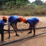The Water Project: Lungi, New York, Robis, #7 Masata Lane -  Fixing Up Tripod