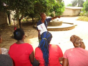 The Water Project:  Hygiene Facilitator Teaching About Bad Hygiene Pratices