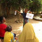 The Water Project: Lungi, New York, Robis, #7 Masata Lane -  Facilitator Compares Healthy And Unhealthy Communities