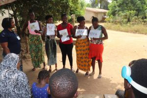 The Water Project:  Participants Displaying Disease Transmission Story