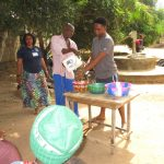 The Water Project: Lungi, New York, Robis, #7 Masata Lane -  Training Participants Demonstrate Tippy Tap Handwashing