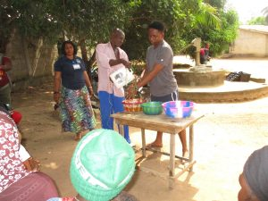 The Water Project:  Training Participants Demonstrate Tippy Tap Handwashing