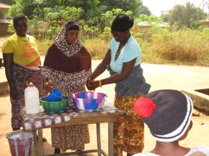 The Water Project:  Training Participants Demostrate A Handwashing Method