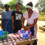 The Water Project: Lungi, New York, Robis, #7 Masata Lane -  Training Participants Demostrating One Of The Handwashing Methods