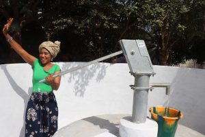The Water Project:  Woman Collecting Safe Drinking Water