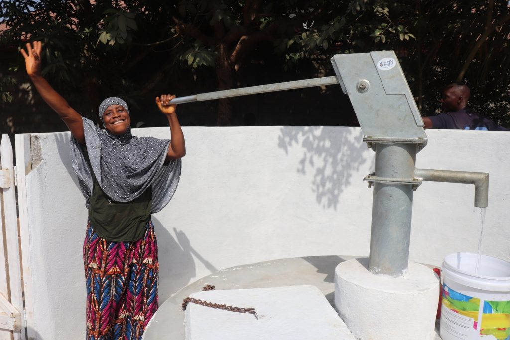 The Water Project : sierraleone20403-woman-collecting-safe-drinking-water-2