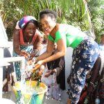 The Water Project: Lungi, New York, Robis, #7 Masata Lane -  Women Splashing Water