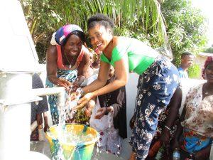 The Water Project:  Women Splashing Water