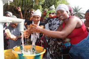The Water Project:  Women Splashing Clean Water