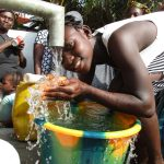 The Water Project: Lungi, New York, Robis, #7 Masata Lane -  Girl Drinking Safe Water