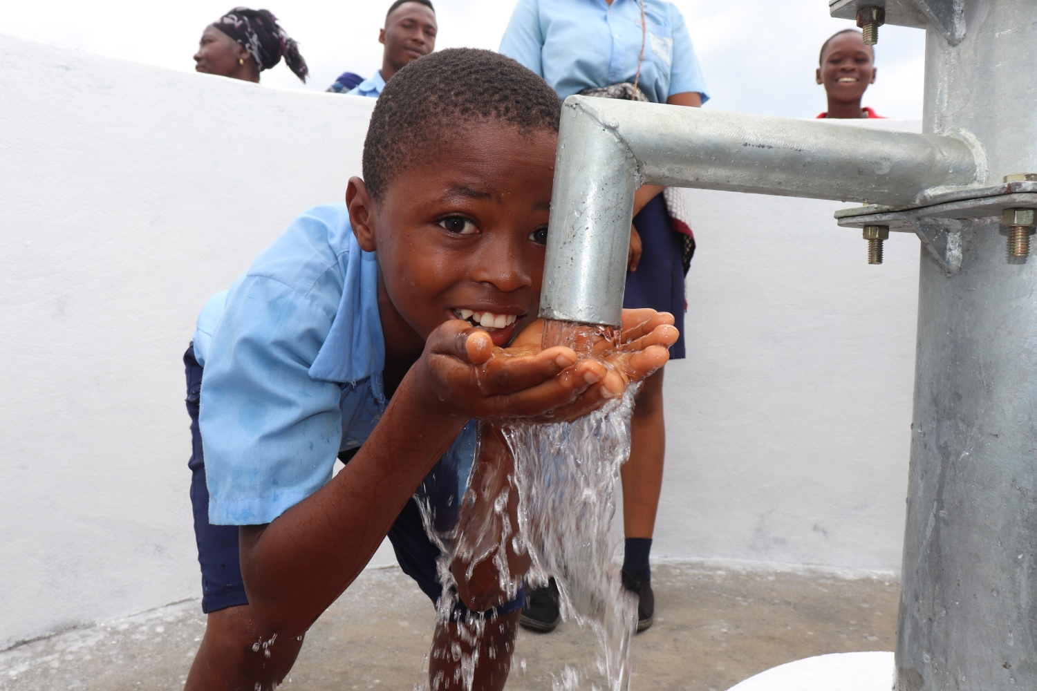 The Water Project : sierraleone20409-student-drinking-clean-and-safe-water-1