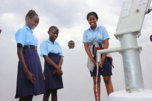 The Water Project:  Students Looking At Clean Water Flowing