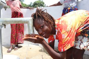 The Water Project:  Girl Drinking Water