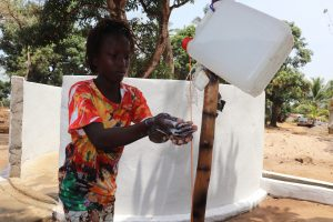 The Water Project:  Girl Handwashing Before Dedication