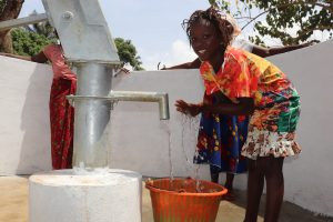 The Water Project:  Girl Splashing Clean Drinking Water