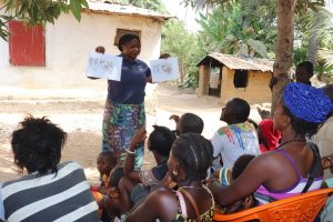 The Water Project:  Hygiene Facilitator Teaching About Healthy And Unhealthy Communities