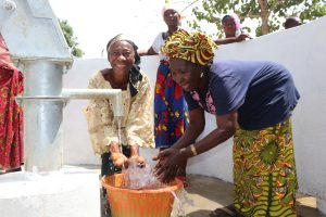 The Water Project:  Old Women Splashing Clean Water