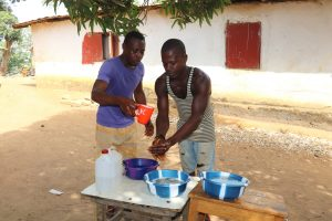The Water Project:  Participants Demonstrate One Handwashing Method