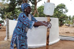 The Water Project:  Section Chief Demonstrates Handwashing Before Dedication
