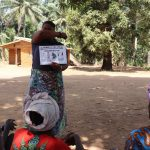 The Water Project: Lokomasama, Gbonkogbonko Village -  Hygiene Facilitator Taeching About Coronavirus