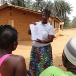The Water Project: Lokomasama, Gbonkogbonko Village -  Hygiene Facilitator Teaching About Bathing
