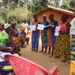 The Water Project: Lokomasama, Gbonkogbonko Village -  Participants Displaying Disease Transmission Story Posters