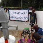 The Water Project: Lokomasama, Gbonkogbonko Village -  Community Kid Celebrating Clean Water