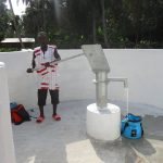 The Water Project: Lokomasama, Gbonkogbonko Village -  Community Member Collecting Water After Pump Installation