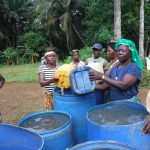 The Water Project: Lokomasama, Gbonkogbonko Village -  Community Members Collecting Water For Drilling