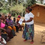 The Water Project: Lokomasama, Gbonkogbonko Village -  Hygiene Facilitator Teaching About Clotheslines
