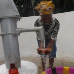 The Water Project: Lokomasama, Gbonkogbonko Village -  Woman Joyfully Looking At Clean Water