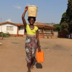 The Water Project: Lungi, Rotifunk, Paramount Chief's Compound -  Carrying Water