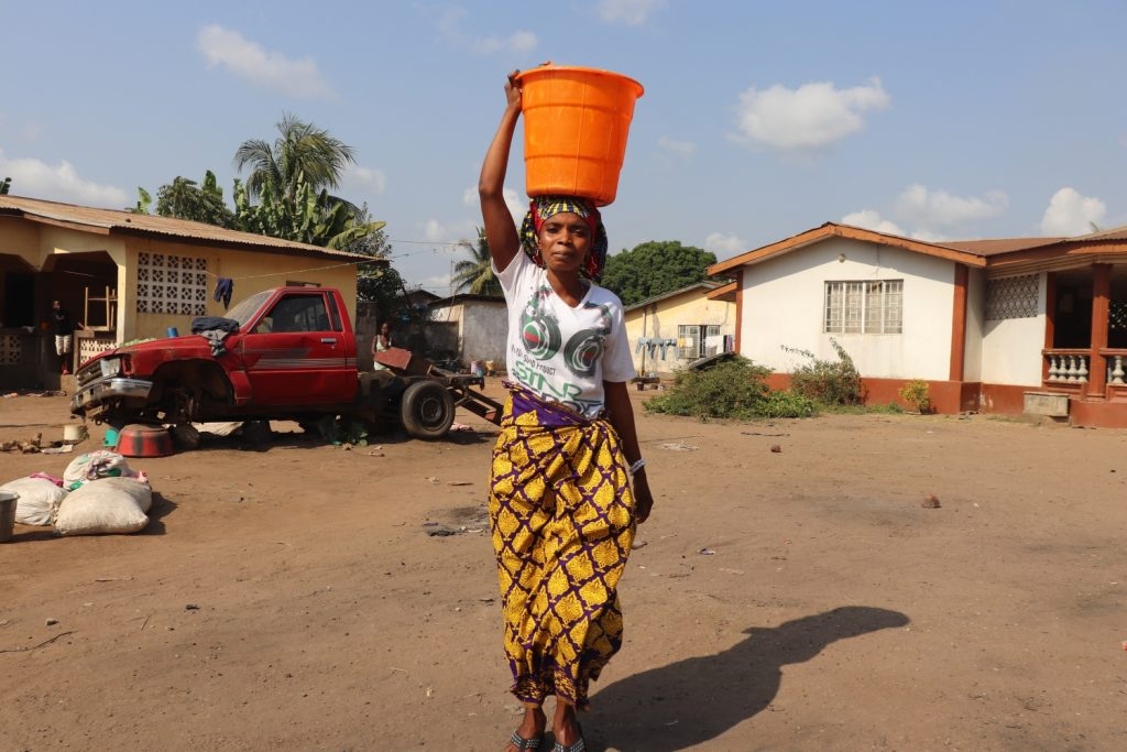 The Water Project : sierraleone21509-carrying-water-4